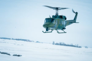 A UH-1N Iroquois from the 54th Helicopter Squadron flies over Minot Air Force Base's missile complex, N.D., Jan. 25, 2017. Photo courtesy of the U.S. Air Force