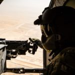 A U.S. Army UH-60 Black Hawk helicopter crew chief assigned to Task Force Griffin, 16th Combat Aviation Brigade, 7th Infantry Division scans below during a flight near Kunduz, Afghanistan, May 31, 2017. The Griffins are working hard to support U.S. Forces Afghanistan as part of Operation Freedom's Sentinel and Resolute Support Mission.