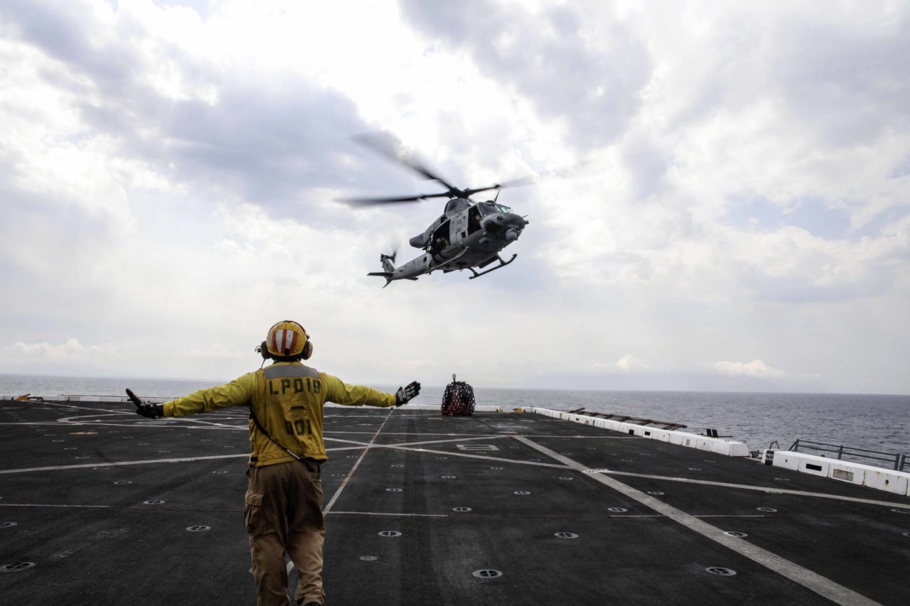 170405-N-FM530-157 MEDITERRANEAN SEA (April 5, 2017) Chief Aviation Boatswain's Mate (Handling) Eugene Williams, assigned to the amphibious transport dock ship USS Mesa Verde (LPD 19), signals a UH-1Y Huey helicopter assigned to Marine Medium Tiltrotor Squadron (VMM) 365 (Reinforced) after it delivers supplies during a vertical replenishment. Mesa Verde is deployed with the Bataan Amphibious Ready Group to support maritime security operations and theater security cooperation efforts in the U.S. 6th Fleet area of operations. (U.S. Navy photo by Mass Communication Specialist 2nd Class Brent Pyfrom/Released)